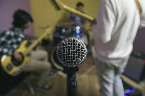 Microphone with  music band rehearsing in background - ABZF000321