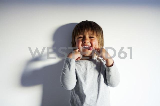 Portrait of little boy pulling funny faces - VABF000402
