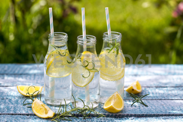 Slice of lemon and rosmary in water bottles, drinking straws - SARF002670