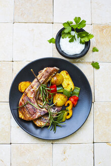 Lamb chops, potatoes and grilled vegetables on plate - KSWF001757