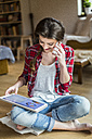 Young woman at home working with digital tablet - HAPF000277