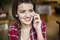 Young happy woman talking on the phone - HAPF000280