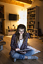 Young woman at home working with digital tablet - HAPF000295