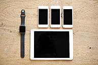 Digital tablet, smartwatch and three smartphones on wood - MFRF000585