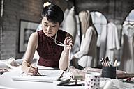 Wedding dress designer working - ZEF008626