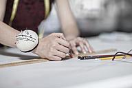 Wedding dress designer working - ZEF008653