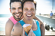 Los Angeles, Venice, portrait of happy gay couple with ice cream cone - LEF000052