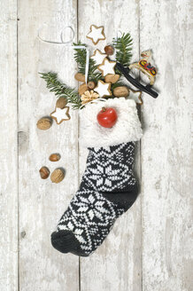 Sock filled with cinnamon stars and nuts on St. Nicholas Day - ASF005875