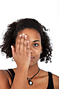 Portrait of young woman covering half of face with her hand - KLRF000283