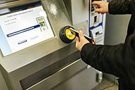 UK, London, man buying cashless a ticket at ticket machine - MGOF001683