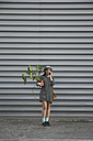 Woman telephoning with smartphone carrying a Monstera deliciosa - RTBF000080