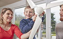 Family assembling toy wind turbine together - RHF001407