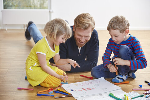 Father lying on floor with children painting - RHF001446