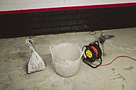 Cement bag, bucket and cable roll at construction site - RAEF001004