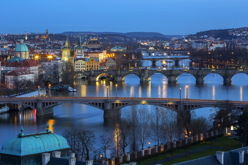 Czechia, Prague, city view with river Vltava and Charles Bridge at sunset - YRF000096