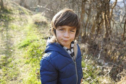 Portrait of little boy pouting mouth - VABF000424
