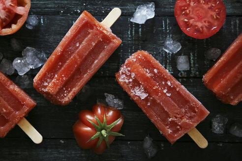 Tomato ice lollies on black wood - RTBF000087