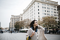 Spain, Barcelona, happy young woman in the city - JRFF000526