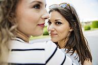 Two smiling young women outdoors - AIF000302