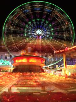 Germany, Furth, Big wheel and carousel at night - VRF000165