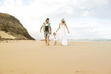 Spain, Fuerteventura, Jandia, family walking on beach - MFRF000604