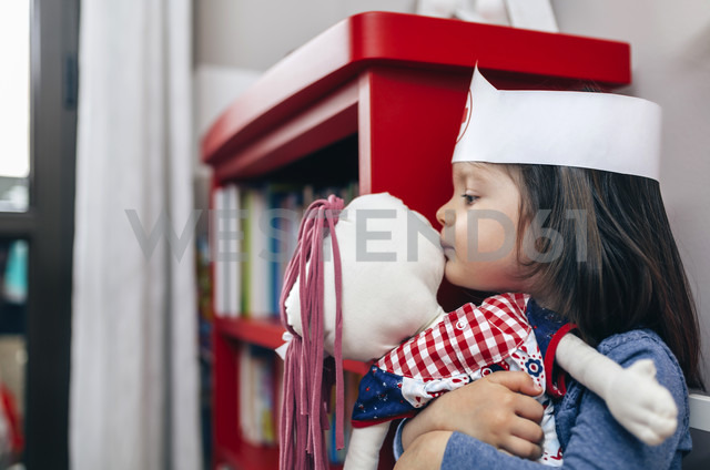 Little girl hugging and kissing her doll - DAPF000085