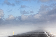 Iceland, Snaefellsnes, empty road, snow storm - FCF000920