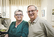 Portrait of confident senior couple at home - EPF000069