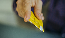 Man's hand holding credit card, close-up - JPF000133