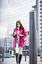 Young woman in the city using mobile phone - UUF006865