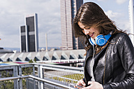 Young woman with headphones using smart phone - UUF006922