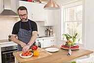 Man preparing vegetables in the kitchen - BOYF000247
