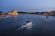 Hungary, Budapest, tourist boats on river danube, parliament building in the background - TKF000442