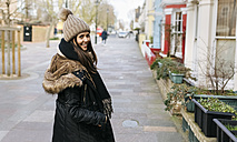 UK, London, Notting Hill, portrait of smiling young woman - MGOF001720