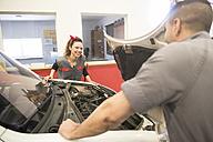 Mechanics working in workshop, engine compartment - JASF000669