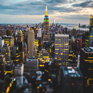 USA, New York City, illuminated Manhattan in the evening seen from above - GIOF000892