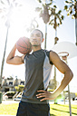 Portrait of self-confident basketball player on outdoor court - LEF000097
