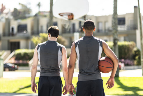Rear view of two basketball players outdoors - LEF000111