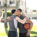 Two basketball players embracing outdoors - LEF000114