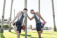 Two basketball players stretching outdoors - LEF000117