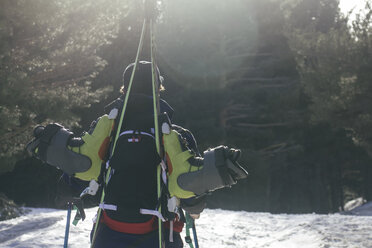 Backlighting of a man with skis in a backpack - ABZF000353