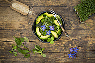 Detox Bowl of different lettuces, vegetables, cress, quinoa, avocado and starflowers - LVF004763