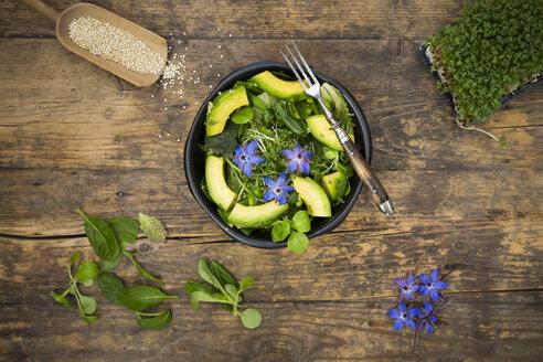Detox Bowl of different lettuces, vegetables, cress, quinoa, avocado and starflowers - LVF004763