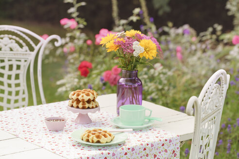 Liege waffles on laid garden table - ECF001876