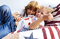 Two little brothers playing together at home - MGOF001764