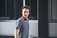 Portrait of young man with headphones and digital tablet - DIGF000329