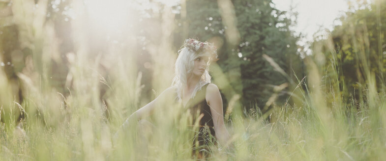 Girl with flowers in her hair during sunset - ANHF000021
