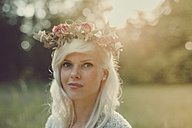 Girl with flowers in her hair during sunset - ANHF000024