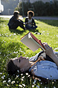 Young woman in park reading book - MAUF000468