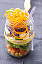 Rainbow salad in a glass with chickpeas, tomatoes, carrots, red cabbage, red radishes, lettuce and feta cheese - SARF002693